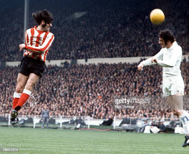 Football 1973 FA Cup Final Wembley Stadium 5th May Sunderland 1 v Leeds United 0 Sunderland's Billy Hughes jumps up for the ball watched by Leeds...