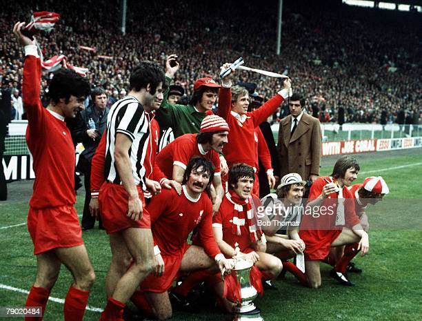 Football 1974 FA Cup Final Wembley Stadium 4th May Liverpool 3 v Newcastle United 0 The Liverpool team celebrate with the FA Cup trophy after the...