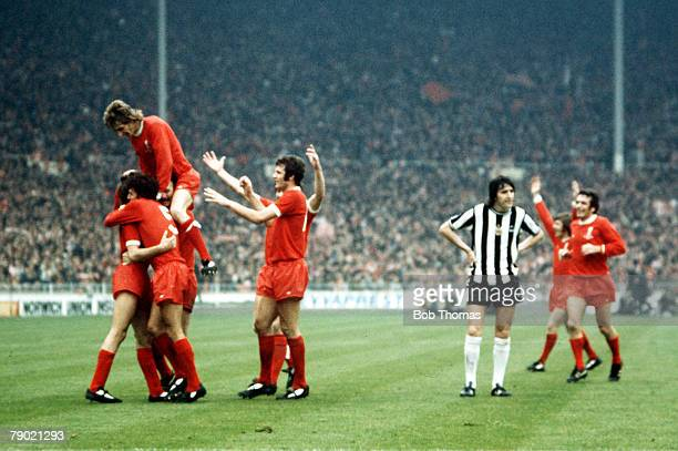 Football 1974 FA Cup Final Wembley Stadium 4th May Liverpool 3 v Newcastle United 0 Liverpool's Steve Heighway is mobbed by teammates after he scored...