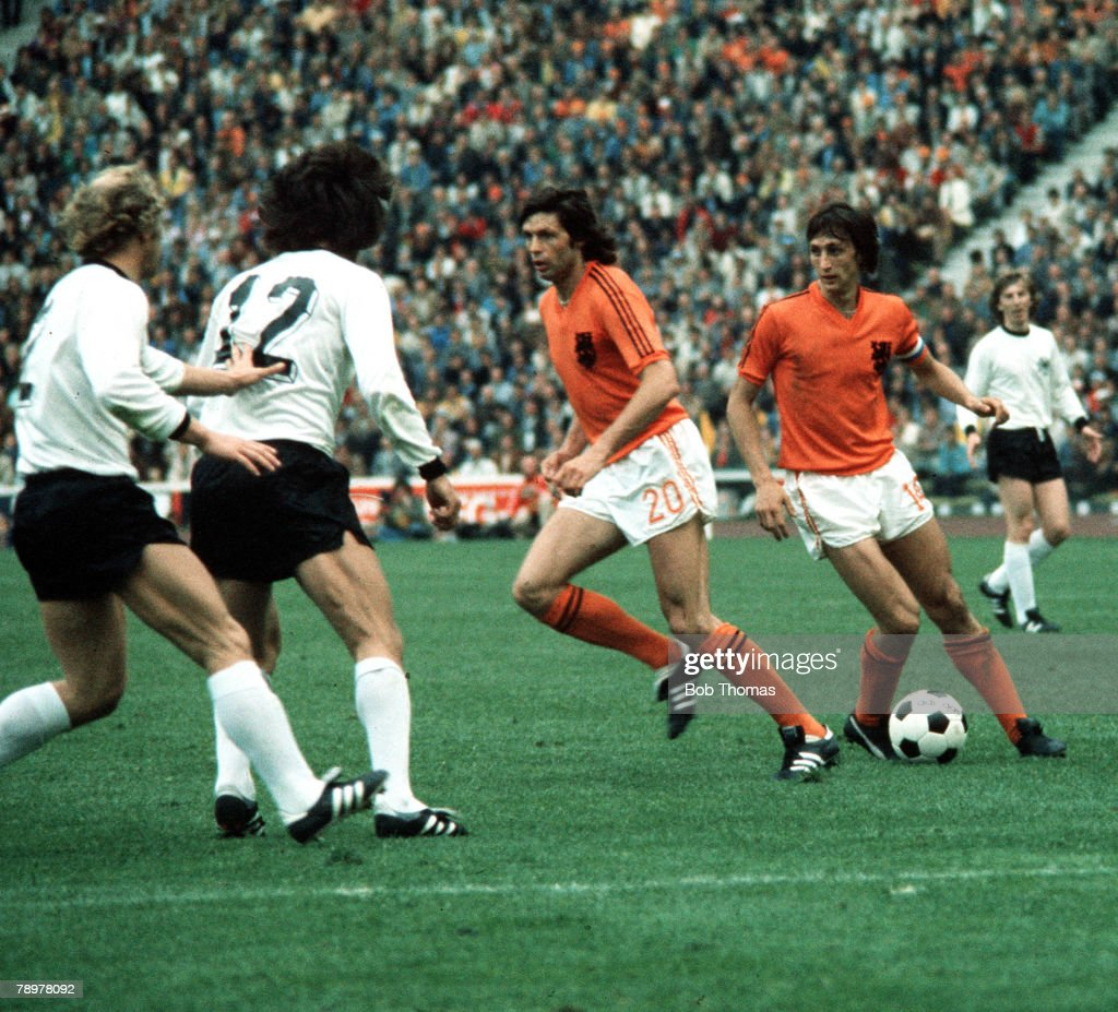 Football. 1974 World Cup Final. Olympic Stadium, Munich, Germany. 7th July 1974. West Germany 2 v Holland 1. Holland's Johan Cruyff on the ball with Suurbier (20) supporting. : News Photo