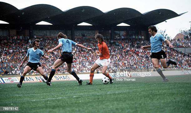 Football 1974 World Cup Finals 15th June 1974 Hannover Germany Holland 2 v Uruguay 0 Holland's Rob Rensenbrink takes on Uruguay's lr Masnik Forlan...