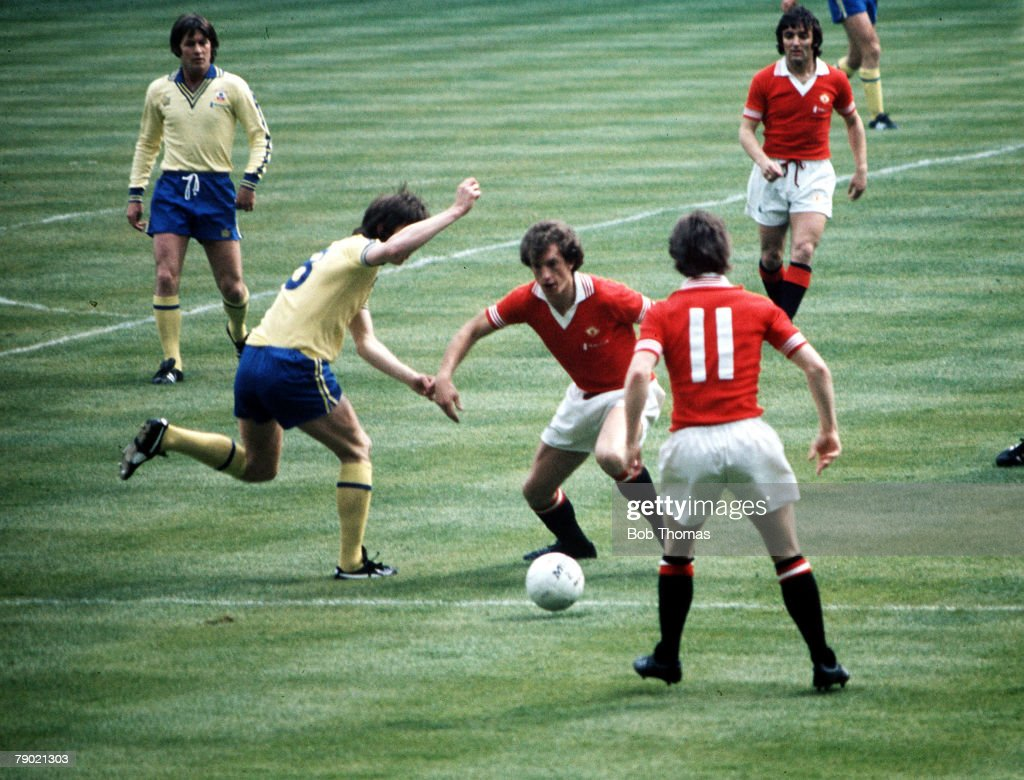 Football. 1976 FA Cup Final. Wembley Stadium. 1st May, 1976. Southampton 1 v Manchester United 0. Manchester United's Stewart Houston on the ball. : News Photo