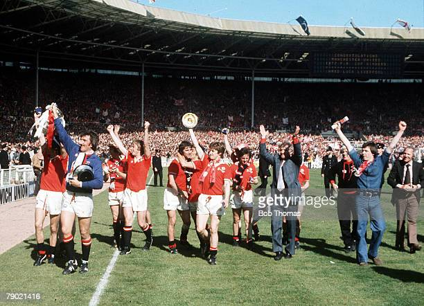 Football 1977 FA Cup Final Wembley Manchester United 2 v Liverpool 1 21st May Manchester United players parade the FA Cup trophy to their fans on a...