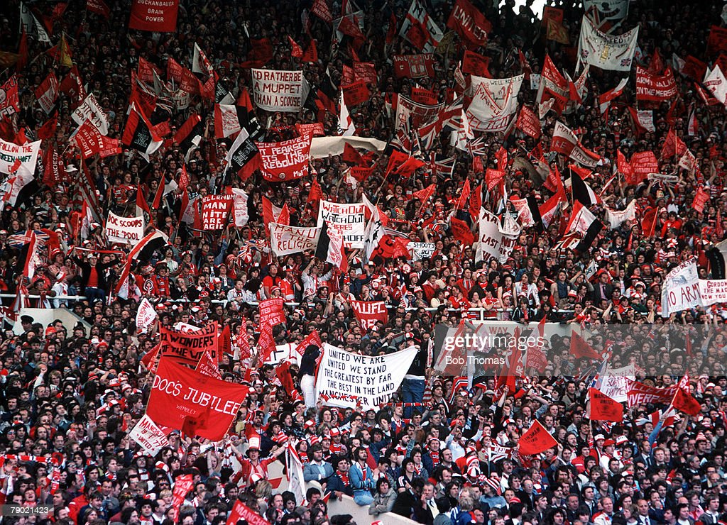 Football. 1977 FA Cup Final. Wembley. Manchester United 2 v Liverpool 1. 21st May, 1977. A crowd of Manchester United fans waving flags and banners to cheer on their team. : News Photo