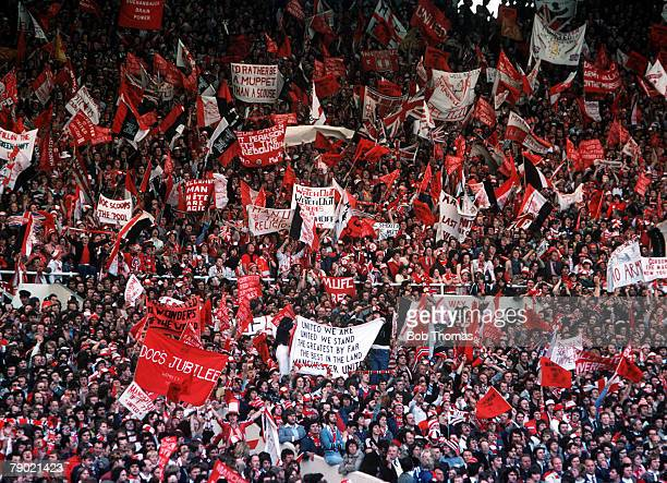 Football 1977 FA Cup Final Wembley Manchester United 2 v Liverpool 1 21st May A crowd of Manchester United fans waving flags and banners to cheer on...