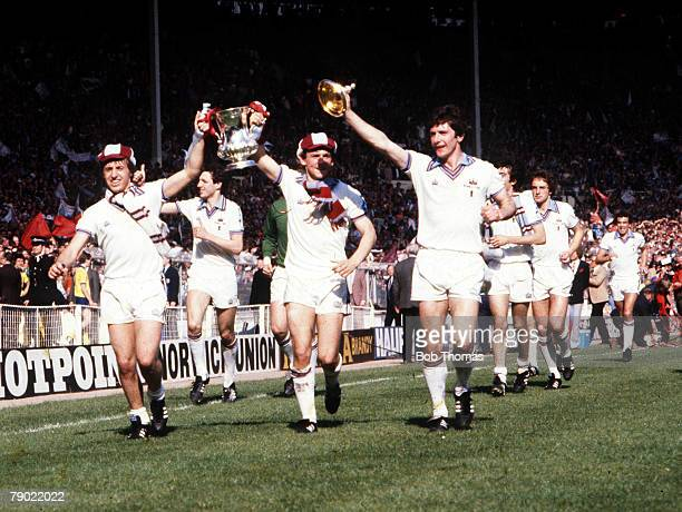 Football 1980 FA Cup Final Wembley 10th May West Ham United 1 v Arsenal 0 West Ham players Geoff Pike and Paul Allen proudly parade the trophy to...