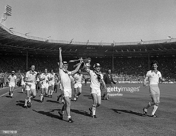 Football 1980 FA Cup Final Wembley 10th May West Ham United 1 v Arsenal 0 West Ham's Geoff Pike and Paul Allen proudly parade the trophy to their...
