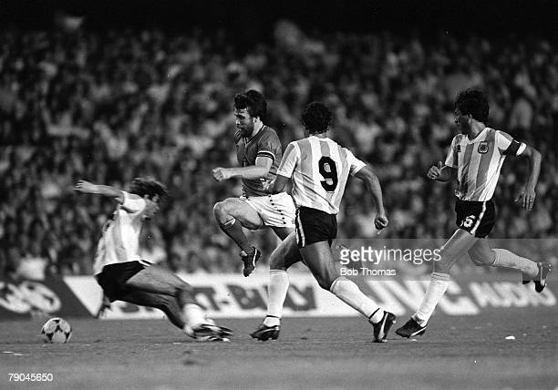 Football 1982 World Cup Finals Barcelona Spain 13th June 1982 Argentina 0 v Belgium 1 Hero Belgium's Eric Gerets flies over the sliding challenge of...