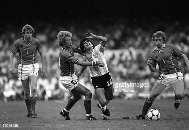 Football 1982 World Cup Finals Barcelona Spain 13th June 1982 Argentina 0 v Belgium 1 Argentina's Diego Maradona is shaken off the ball by Belgium's...
