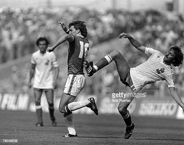 Football 1982 World Cup Finals Bilbao Spain 16th June 1982 England 3 v France 1 England's Bryan Robson receives a kick in the back from France's Rene...