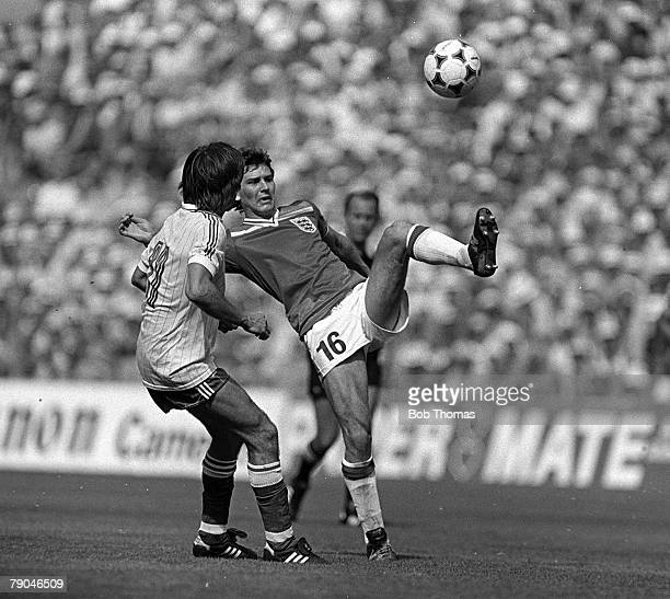 Football 1982 World Cup Finals Bilbao Spain 16th June 1982 England 3 v France 1 England's Bryan Robson beats France's Rene Girard to the ball during...