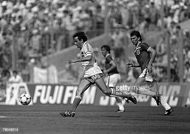Football 1982 World Cup Finals Bilbao Spain 16th June 1982 England 3 v France 1 England's Bryan Robson chases France's Michel Platini for the ball...