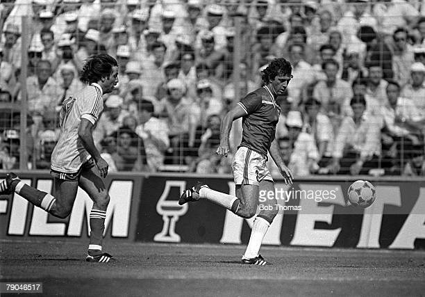Football 1982 World Cup Finals Bilbao Spain 16th June 1982 England 3 v France 1 England's Trevor Francis is chased for the ball by France's Rene...