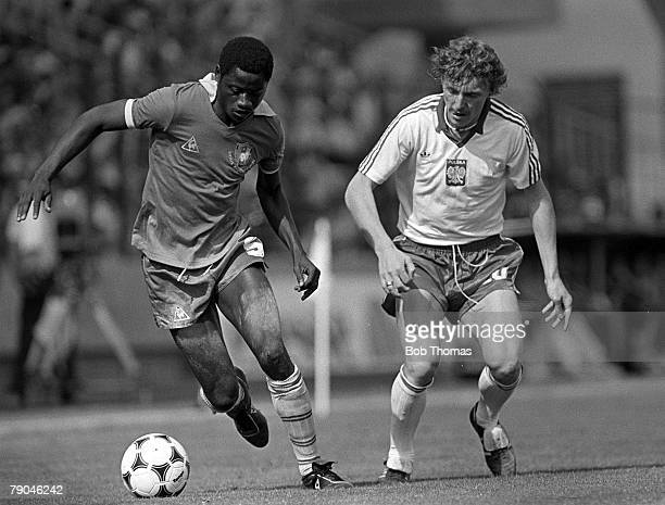 Football 1982 World Cup Finals La Coruna Spain 19th June 1982 Cameroon 0 v Poland 0 Poland's Zbigniew Boniek moves in to challenge Cameroon's Elie...
