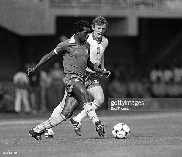 Football 1982 World Cup Finals La Coruna Spain 19th June 1982 Cameroon 0 v Poland 0 Poland's Zbigniew Boniek moves in to challenge Cameroon's...