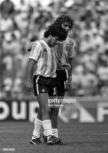 Football 1982 World Cup Finals Second Phase Group C Barcelona Spain 2nd July 1982 Brazil 3 v Argentina 1 Argentina's Diego Maradona is commiserated...