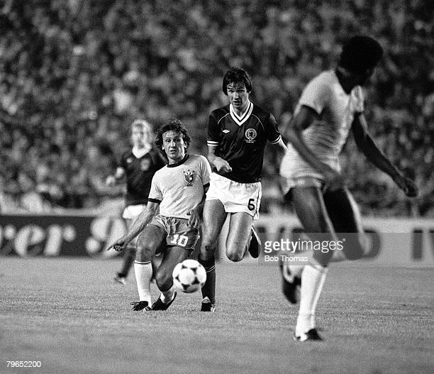 Football 1982 World Cup Finals Seville Spain 18th June 1982 Brazil 4 v Scotland 1 Brazil's Zico plays the ball through to a teammate as Scotland's...