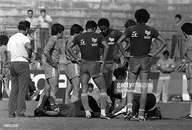 Football 1982 World Cup Finals Spain Brazil's Junior is treated for an injury during a training session as teammates crowd round