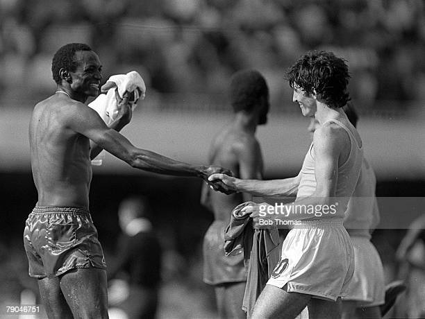 Football 1982 World Cup Finals Vigo Spain 23rd June 1982 Italy 1 v Cameroon 1 Cameroon's Michel Kaham gleefully exchanges shirts and shakes hands...