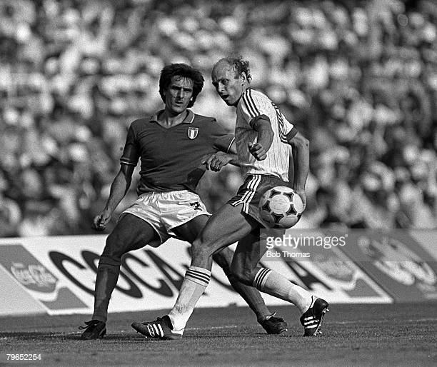 Football 1982 World Cup Semi Final Barcelona Spain 8th July 1982 Italy 2 v Poland 0 Poland's Grzegorz Lato moves in to challenge Italy's Gaetano...