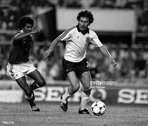 Football 1982 World Cup Semi Final Seville Spain 8th July 1982 West Germany 3 v France 3 aet West Germany's Paul Breitner is chased for the ball by...