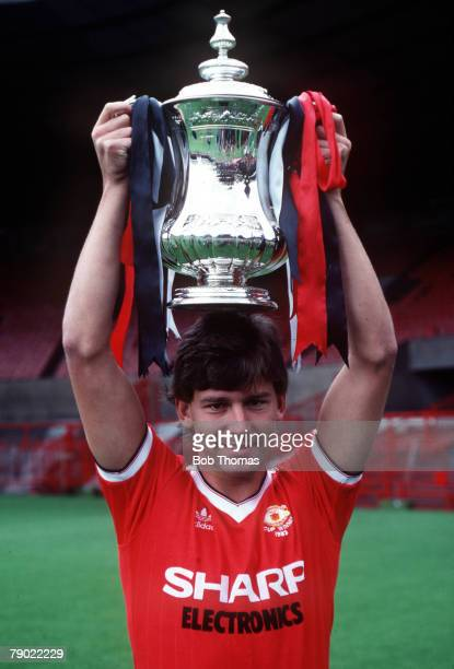Football 1983 FA Cup August Manchester United captain Bryan Robson holds aloft the FA Cup trophy at Old Trafford