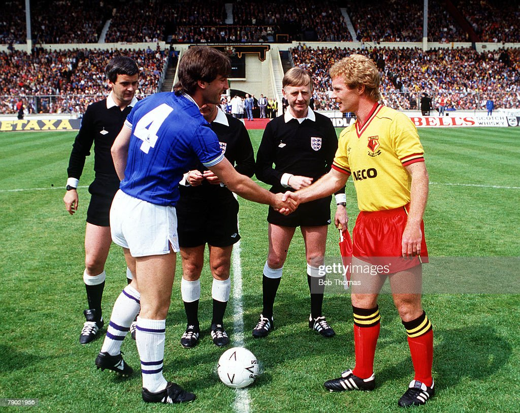 Football, 1984 FA Cup Final, Wembley, 19th May, 1984, Everton 2 v Watford 0, Everton captain Kevin Ratcliffe shakes hands with Watford captain Les Taylor at the toss up before the start of the game