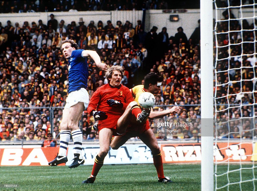 Football, 1984 FA Cup Final, Wembley, 19th May, 1984, Everton 2 v Watford 0, Everton's Andy Gray jumps up for the ball to score the second goal past Watford goalkeeper Steve Sherwood