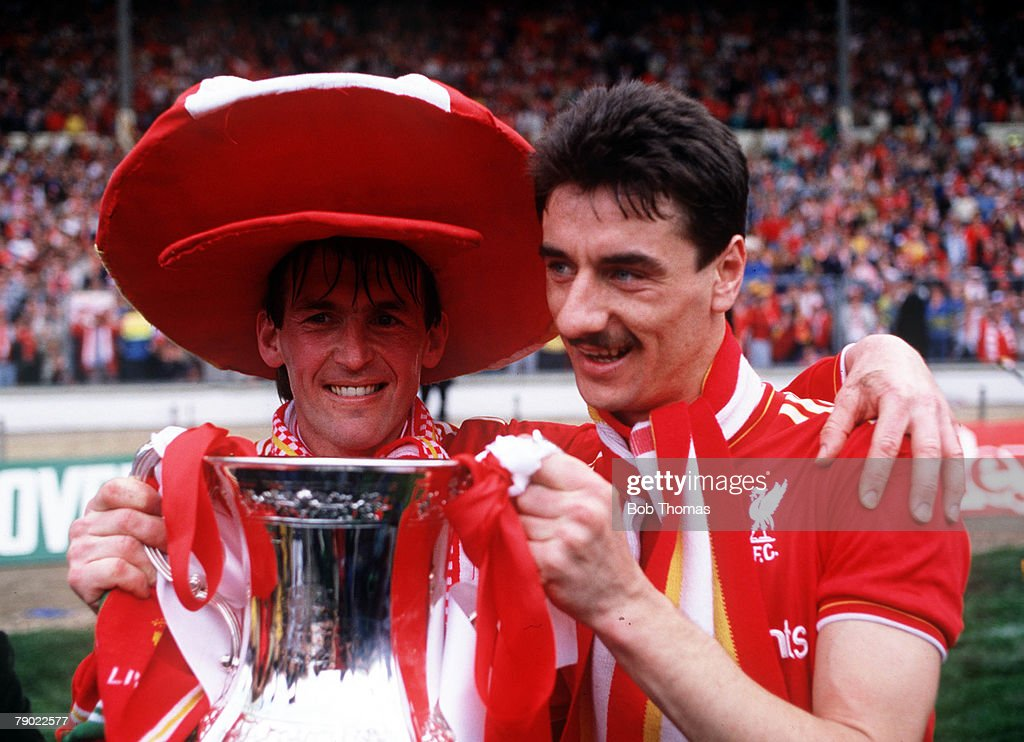 Football, 1986 FA Cup Final, Wembley, 10th May, 1986, Liverpool 3 v Everton 1, Liverpool player manager Kenny Dalglish and striker Ian Rush celebrate with the FA Cup trophy