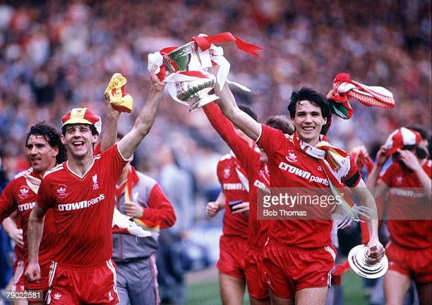 Football, 1986 FA Cup Final, Wembley, 10th May Liverpool 3 v Everton 1, Liverpool captain Alan Hansen and Jim Beglin proudly hold aloft the trophy as...