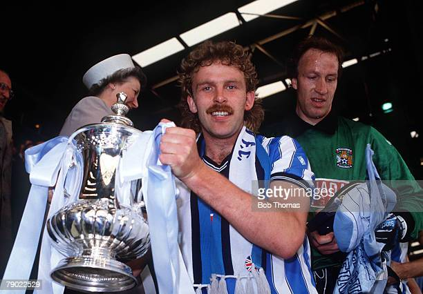 Football 1987 FA Cup Final Wembley 16th May Coventry City 3 v Tottenham Hotspur 2 Coventrys captain Brian Kilcline proudly holds the trophy after the...
