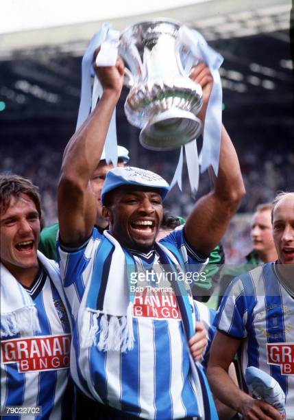 Football 1987 FA Cup Final Wembley 16th May Coventry City 3 v Tottenham Hotspur 2 Coventry's Cyrille Regis proudly holds aloft the trophy at the end...