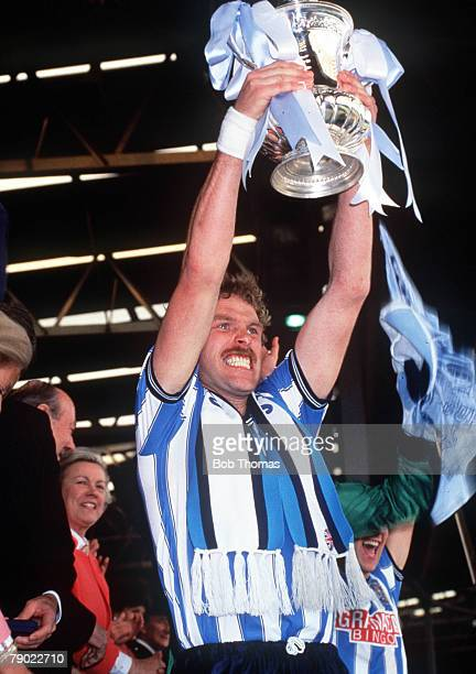 Football 1987 FA Cup Final Wembley 16th May Coventry City 3 v Tottenham Hotspur 2 Coventry's captain Brian Kilcline proudly holds aloft the trophy...