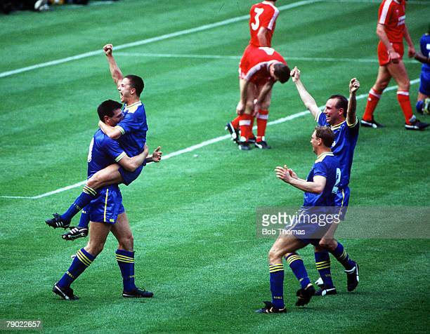 Football 1988 FA Cup Final Wembley 14th May Wimbledon 1 v Liverpool 0 Wimbledon's Dennis Wise is carried by goalscorer Lawrie Sanchez as they...