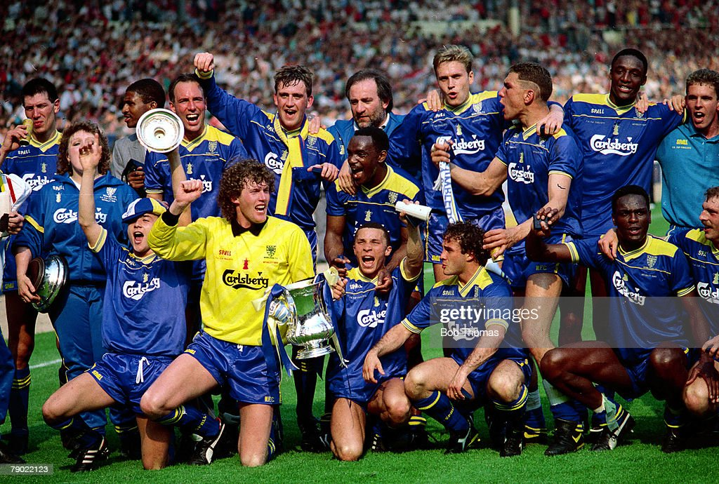 Football. 1988 F.A.Cup Final. Wembley. Wimbledon. 1. v Liverpool. 0. 14th May 1988. Wimbledon, the 1988 F.A. Cup winners celebrate with the F.A. Cup. : News Photo