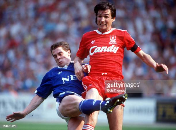 Football 1989 FA Cup Final Wembley 20th May Liverpool 3 v Everton 2 Everton's Tony Cottee and Liverpool's captain Alan Hansen in a challenge for the...