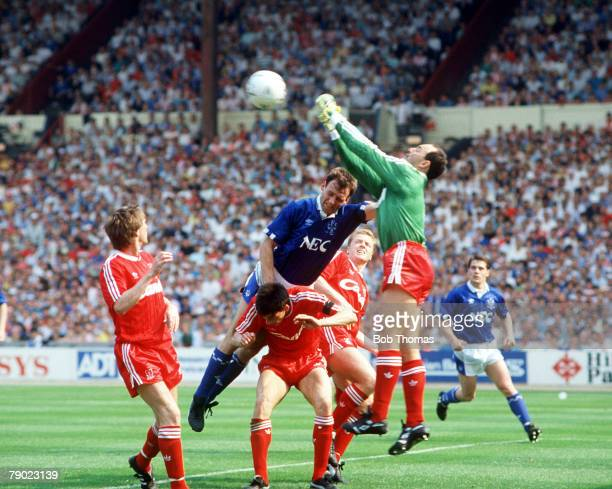 Football, 1989 FA Cup Final, Wembley, 20th May Liverpool 3 v Everton 2 Liverpool's goalkeeper Bruce Grobbelaar comes out to punch the ball clear from...