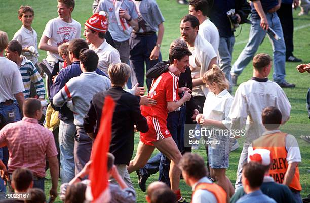 Football 1989 FA Cup Final Wembley 20th May Liverpool 3 v Everton 2 Liverpool's Ian Rush is mobbed by jubilant fans who have invaded the Wembley...