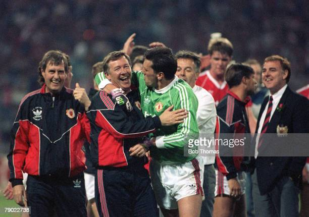 Football 1990 FA Cup Final Replay Wembley 17th May Manchester United 1 v Crystal Palace 0 Jubilant Manchester United manager Alex Ferguson hugs his...