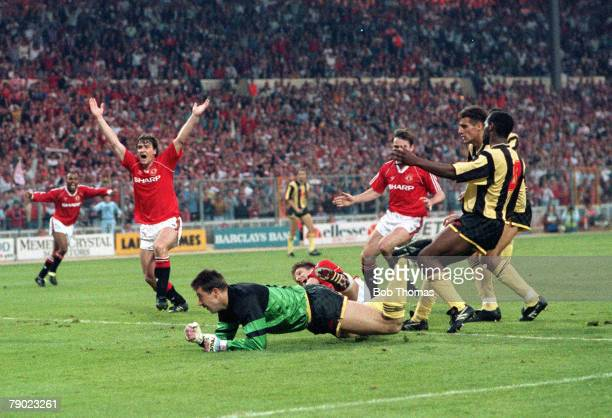 Football 1990 FA Cup Final Replay Wembley 17th May Manchester United 1 v Crystal Palace 0 Manchester United player Mark Hughes has his arms raised as...