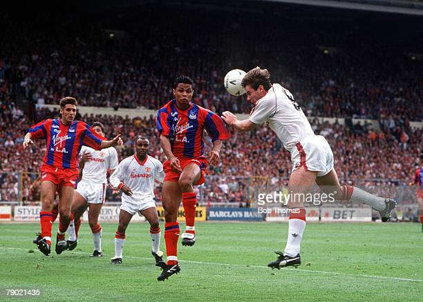 Football 1990 FA Cup Final Wembley 12th May Manchester United 3 v Crystal Palace 3 Manchester United's Brian McClair leaps up to head the ball in...