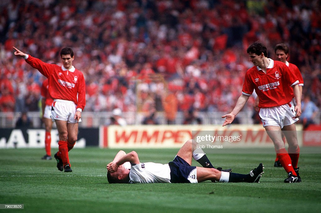 Football. 1991 FA Cup Final. Wembley. 18th May, 1991. Tottenham Hotspur 2 v Nottingham Forest 1. Spurs' Paul Gascoigne lies in agony on the pitch after injuring his knee following a collision with Gary Charles. : News Photo