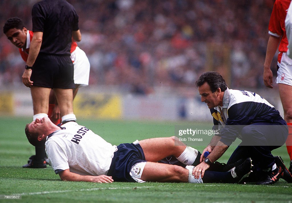 Football. 1991 FA Cup Final. Wembley. 18th May, 1991. Tottenham Hotspur 2 v Nottingham Forest 1. Spurs' Paul Gascoigne in agony on the pitch after injuring his knee following a collision with Gary Charles. : News Photo