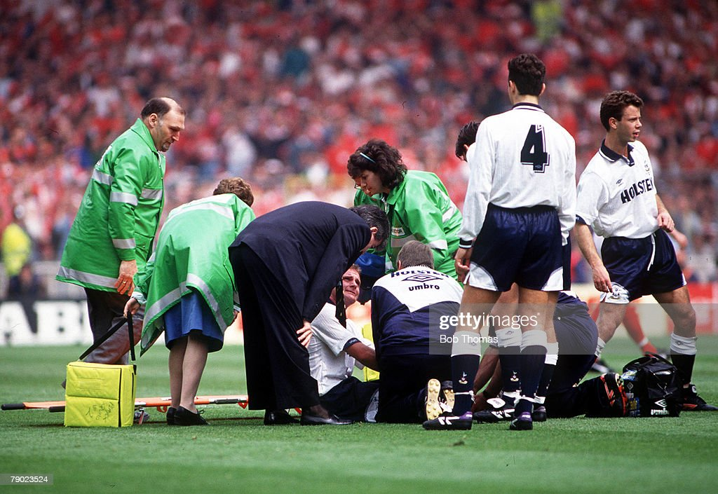 Football. 1991 FA Cup Final. Wembley. 18th May, 1991. Tottenham Hotspur 2 v Nottingham Forest 1. Spurs' Paul Gascoigne is helped onto a stretcher after injuring his knee following a collision with Forest's Gary Charles as manager Terry Venables anxiously  : News Photo