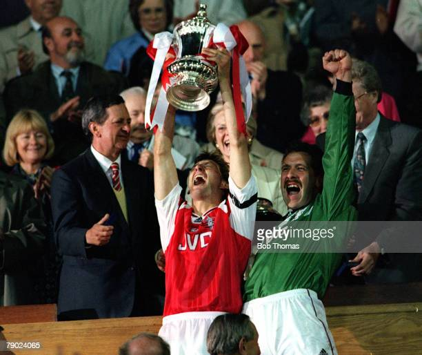 Football 1993 FA Cup Final Wembley 15th May Arsenal 1 v Sheffield Wednesday 1 Arsenal's captain Tony Adams proudly holds aloft the trophy as he...