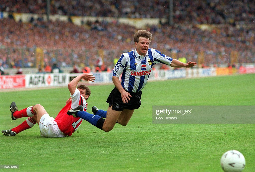 Football. 1993 FA Cup Final. Wembley. 15th May, 1993. Arsenal 1 v Sheffield Wednesday 1. Wednesday's Roland Nilsson goes flying over a challenge from Arsenal's John Jensen. : News Photo