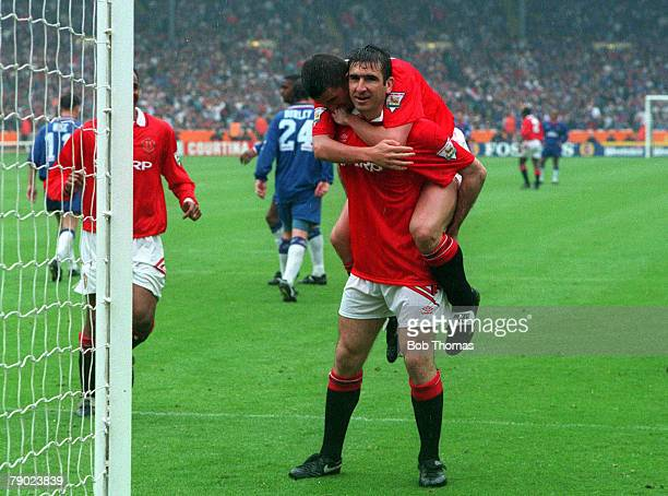 Football 1994 FA Cup Final Wembley 14th May Manchester United 4 v Chelsea 0 Manchester United's Eric Cantona is congratulated by teammates after...