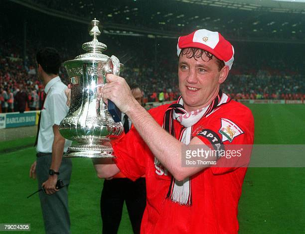 Football 1994 FA Cup Final Wembley 14th May Manchester United 4 v Chelsea 0 Manchester United's captain Steve Bruce proudly holds aloft the trophy...