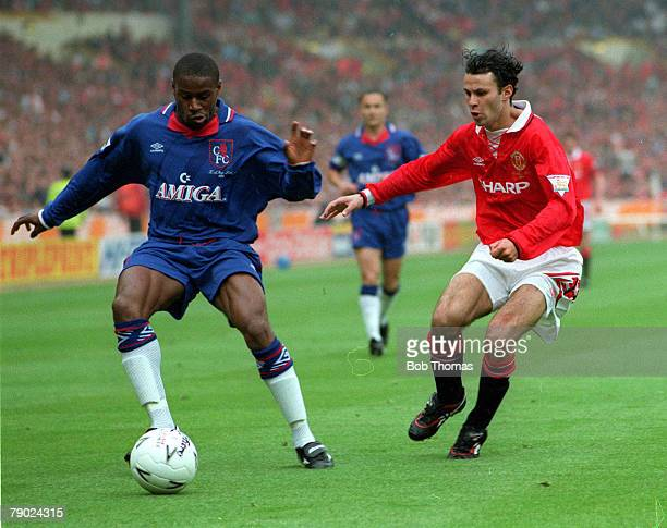 Football 1994 FA Cup Final Wembley 14th May Manchester United 4 v Chelsea 0 Chelsea's Frank Sinclair is challenged for the ball by Manchester...