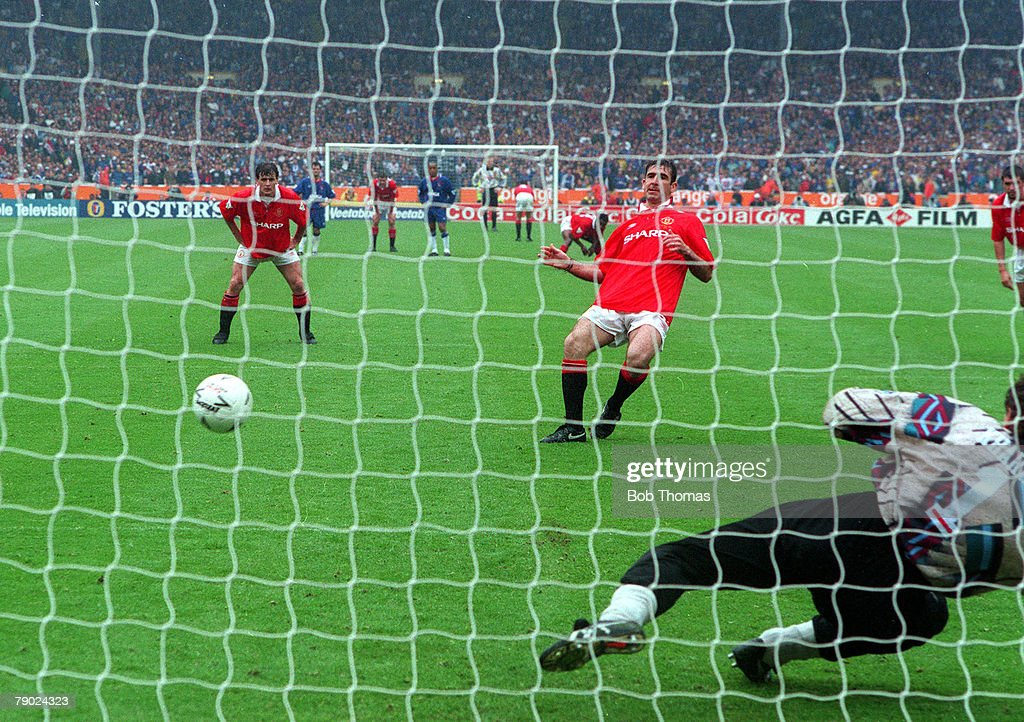 Football. 1994 FA Cup Final. Wembley. 14th May, 1994. Manchester United 4 v Chelsea 0. Manchester United's Eric Cantona scores his side's first penalty as Chelsea goalkeeper Dmitri Kharine dives the wrong way. : News Photo